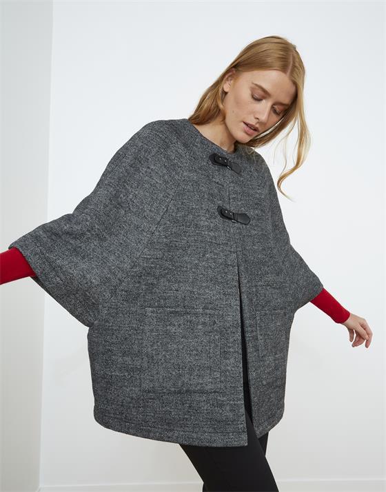Cape longueur standard contenant de la laine pied de puce